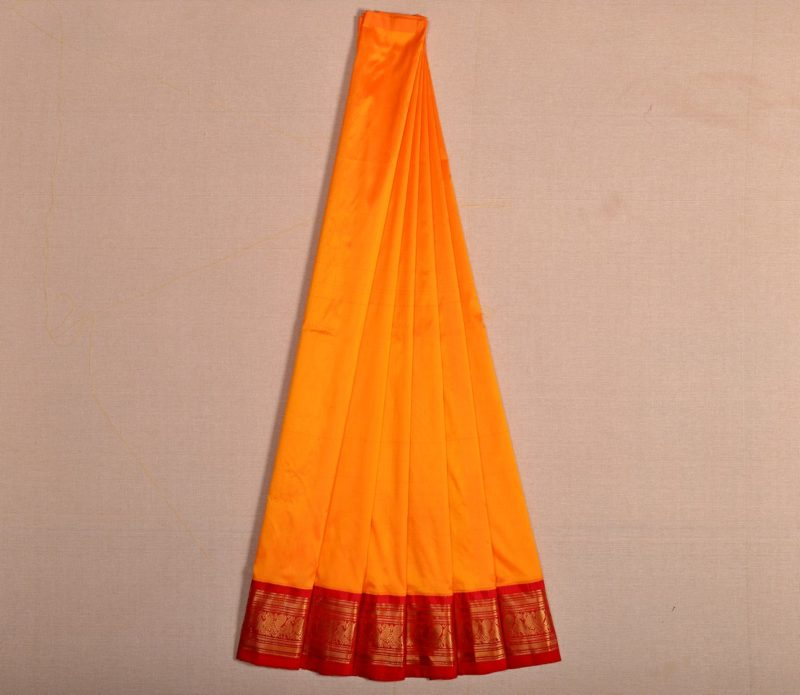 Kanjivaram silk pavadai in mango yellow