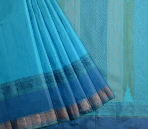 Kanjivaram soft silk in torquoise blue with threadwork and butta blouse