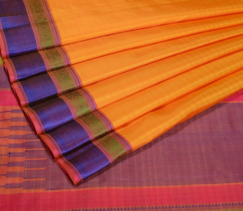 Kanjivaram soft silk in yellow with threadwork and butta blouse