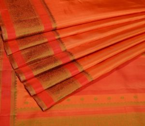 Orange Kanjivaram with yazhi design border and butta blouse